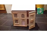 Large wooden kids children's doll's house with loads of furniture and dolls.ideal for christmas.