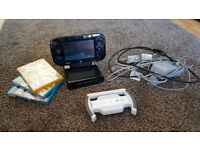 Wii U with three games