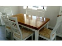 Large extending oak dining table with 6 matching chairs