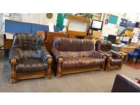 Brown leather wooden framed 3 seater and 2 chairs