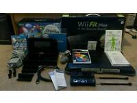 WiiU console with Super Mario Bros game, Wii fit plus board, 2 Wii controllers, trivial pursuit game