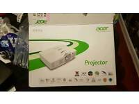 Acer projector with a firestick and 120 inch screen and wireless sound bar