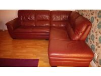 Italian Leather corner suite with a matching three seater for sale.