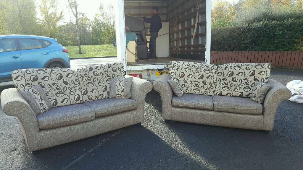 2 small 3 seater sofas in fawn floral fabric