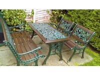 Garden set .. Cast Iron and woodTable , two chairs and 2/3 seater bench