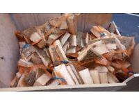 Nets of unseasoned hardwood logs, cut and split