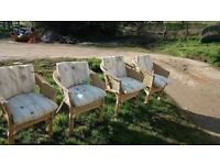 Four lovely wicker garden/conservatory chairs with cushions