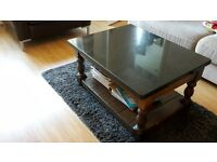 black granite and wood coffee table. great design