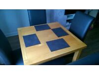 Extendable Wooden Dining Chair with 4 Leather (or faux leather) Chairs and Table mats