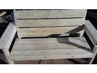 Wooden 2 x seater garden bench made from pressure treated wood.