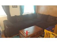 black cord and part soft leather large corner sofa