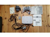 PSone(boxed) and 8 games plus all cables.