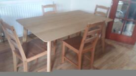 Pine table (60 cm x 120 cm) and 4 chairs. Delivery can be arranged if required