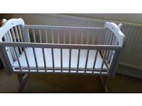 Baby swinging crib, white. Smoke and pet free home.