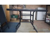 Glass topped blue Patio table and 4 collapsible chairs