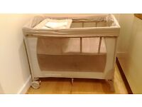 Travel cot with adjustable matress hight and changing table