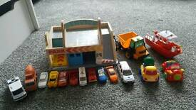 Wooden garage and cars