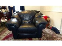 Two dark blue leather armchairs , excellent condition , £50 Ono,