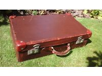 Vintage genuine brown leather suitcase with leather handle and monogrammed
