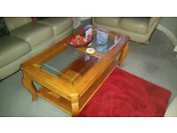 Two lovely glass topped sitting room tables