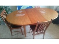 Dining room table - oval, wooden, extendable, 4 chairs