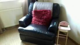 Large L shaped black leather sofa and single