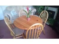 Lovely wood dining table with 4 chairs