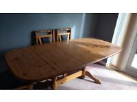 Solid pine extending dining table with six matching chairs