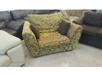 Next brown and green 2 seater lovechair.