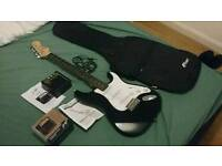 Electric Guitar with Case and Mini-Amp