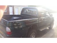 Mitisubishi l200 twin cabe twsted till januay big chunky tyres an good runner