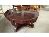 Round Cradled Mahogany Coffee Table in Good Condition