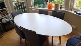 Oval dining table satin white
