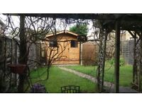 Practical 8ft x 8ft garden shed. Fantastic condition, high level of security and inbuilt features