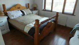 Pine framed double bed