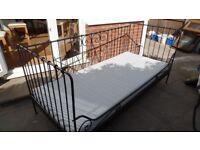 Black metal frame single bed