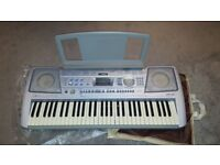 Yamaha PSR-292 touch sensitive 61-key keyboard, adjustable stand and sustain pedal