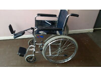 DMA self propelled wheelchair with Drive Medical Steel Elevating Footrest / Leg