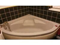 grey corner bath