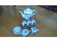 White porcelain coffee set for four.
