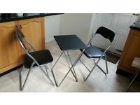 2 chairs and small folding table