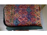 Decorative quilted bed cover.