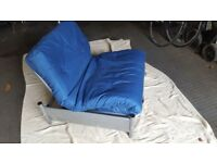metal chair which turns into a single bed