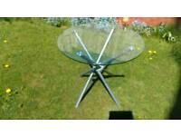 Attractive glass top table for inside or outside