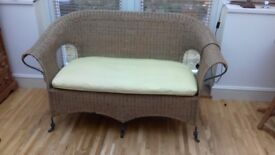 Rattan sofa with puta metal feet from The Pier