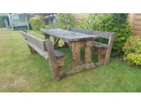 Extra large solid garden table and bench set. Will seat 8 adults with ease