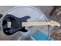 Half size electric guitar with built in amp.