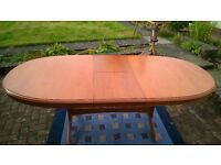 Extending wood dining table and 8 chairs