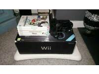 Nintendo Wii Black Console + 4 games + Wii Fit and Balance Board