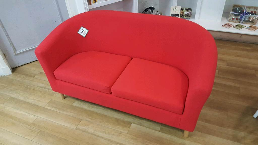 Poppy red 2 seater sofa with wooden legs
